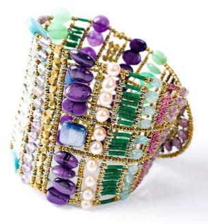 This bold Ziio bracelet is statement jewelry at its best. This artisan Italian bracelet is made with amethyst, susolite, chrysoprase, serpentine, kyanite and sterling silver.