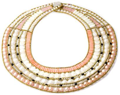 A bold, high-fashion statement necklace by Ziio. This stunning example of Ziio design and craftsmanship is made with pink pearls, white pearls, mother of pearl, black tourmaline, coral and sterling silver.